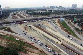 Hà Nội chi hơn 12 tỷ xén dải phân cách 2km đường