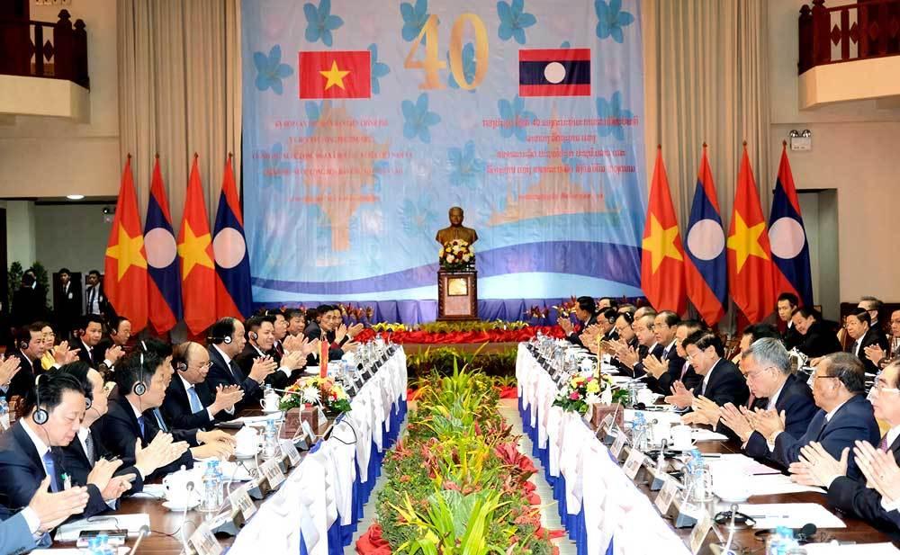 12 văn kiện hợp tác đưa quan hệ Việt-Lào lên tầm cao mới