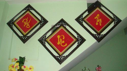 dọn nhà đón tết,trang trí nhà đón tết,treo tranh chữ theo phong thủy