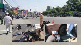Hàng chục người khiêng xe khách cứu 2 nạn nhân trong gầm