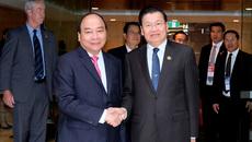 Thủ tướng Việt Nam, Lào gặp gỡ bên lề Hội nghị ASEAN – Australia