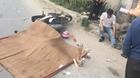 Hà Nội: Va chạm với xe container vợ chết, chồng bị thương