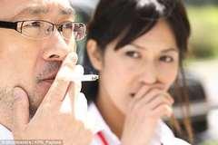 Nhật Bản cấm đi thang máy sau khi hút thuốc