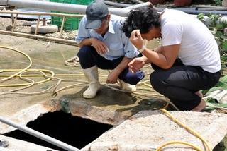 2 cha con tử vong dưới hầm rút nước thải