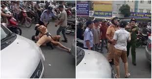 Xôn xao clip cảnh sát giao thông quật ngã lái xe taxi giữa phố