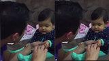 Không nhịn nổi cười trước phản ứng của cô con gái nhỏ khi được bố cắt móng tay