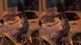 Cô gái vừa đạp xe vừa hít bóng cười khiến nhiều người choáng váng