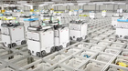 Xem hàng ngàn robot tự phối hợp đóng gói đơn hàng