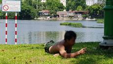 Thanh niên gặm cỏ, nhảy xuống hồ Thiền Quang