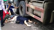 Cô gái nằm dưới gầm xe ben sau va chạm trên đường Hà Nội