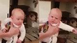 Phản ứng hài hước của em bé khi nghe bố hắt hơi