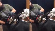 Người đàn ông dùng máy cưa để... cắt tóc