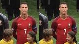 Phản ứng cực đáng yêu của hai em bé người Nga khi được đứng gần Cristiano Ronaldo