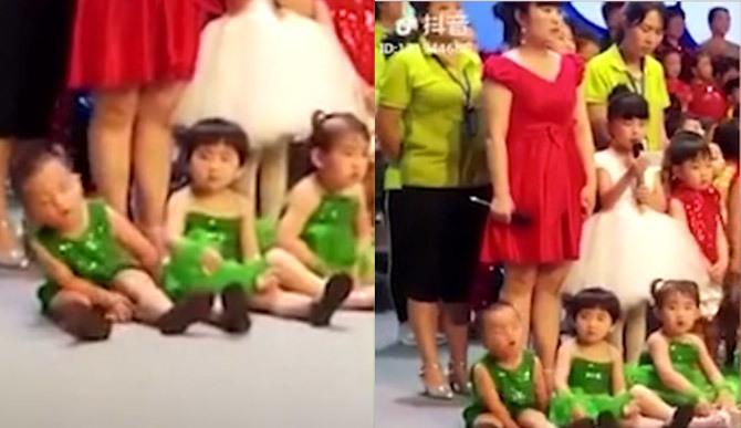 Bé trai ngủ gật khi đang múa khiến các bà mẹ bỉm sữa cười chảy nước mắt