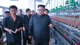 Jong Un thăm xưởng dệt, trách công nhân