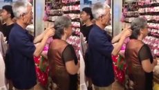 Lịm tim nhìn cụ ông buộc tóc cho cụ bà