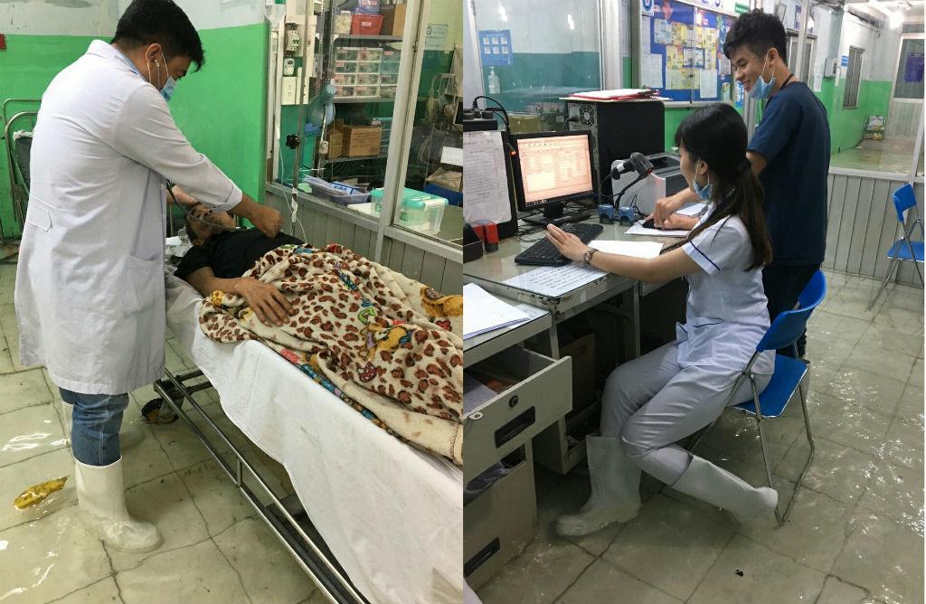 Bệnh viện 'thất thủ', bác sĩ mang ủng bì bõm lội nước cứu người bệnh