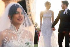 Hoa hậu Thế giới diện váy cưới xuyên thấu bên ông xã kém 10 tuổi
