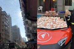 Lái siêu xe rải tiền trên phố: 300 tỷ rơi như lá vàng, dân tranh nhau