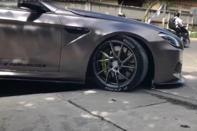 Mẹo độc lái xe sang BMW 6-Series gầm thấp leo vỉa hè