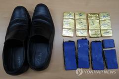Cơ trưởng máy bay cầm đầu phi vụ buôn lậu vàng xuyên quốc gia