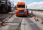 Overloaded trucks destroying Vietnam's roads