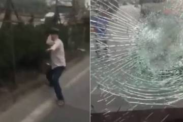 """Người đàn ông cầm gạch ném vỡ kính xe tải, thách thức: """"Gọi công an đi"""""""