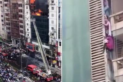 Mạo hiểm bám dây cáp thoát khỏi cao ốc đang cháy ngùn ngụt