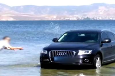 Mang Audi xuống hồ để rửa, tài xế bị phạt tiền nặng