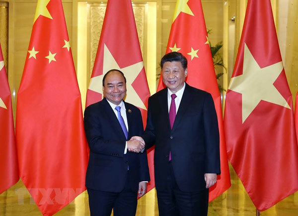 Prime Minister Phuc active in China