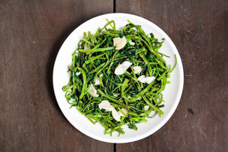 Stir fried morning glory with garlic—a speciality of Vietnam