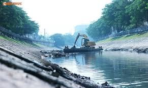 Hanoi's polluted To Lich River turns green again after dredging
