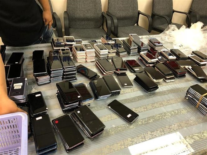 Airport officials seize large quantity of used mobile phones