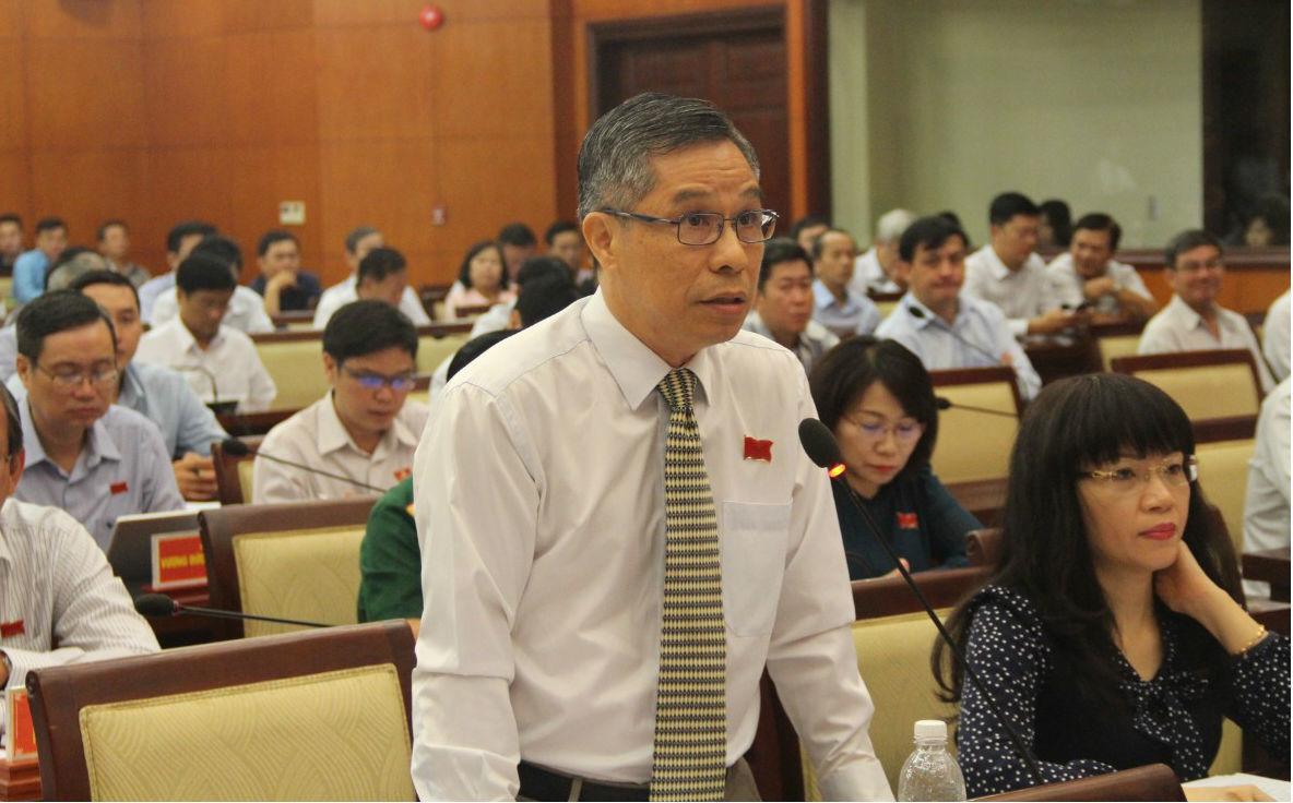 Bị miễn nhiệm, ông Lê Nguyễn Minh Quang vẫn chưa được thôi việc - Ảnh 1.