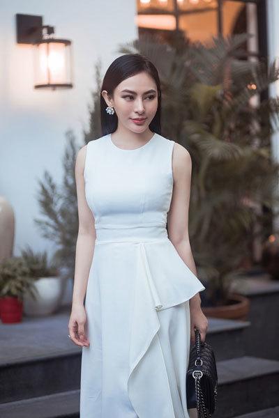 Hoa hậu Thu Hoàng thanh lịch khi diện đồ trắng, đen