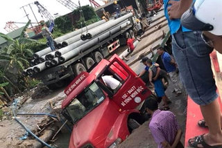 Road collapses after container truck breaks water pipeline