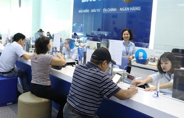 Fitch Ratings,vietnam banks,SBV,vietnam economy,Vietnam business news,business news,vietnamnet bridge,english news,Vietnam news,vietnamnet news