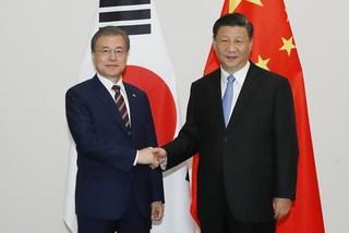 Ông Tập xác nhận Kim Jong Un quyết tâm phi hạt nhân