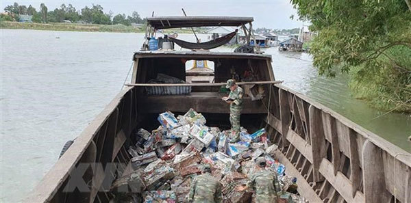 An Giang,iron scrap smuggled from Cambodia to Vietnam,seized,social news,english news,Vietnam newsvietnamnet news,Vietnam latest news,Vietnam breaking news,Vietnamese newspaper,Vietnamese newspaper articles