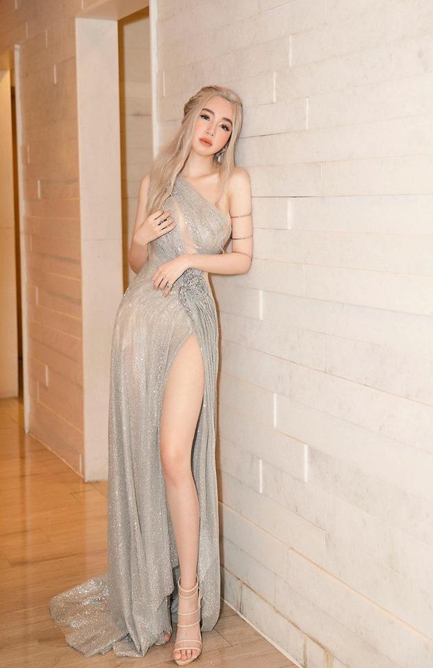 Elly Trần photoshop quá đà đến cong vênh cả đồ vật