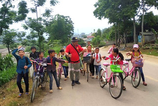 South Korean group walks to remote villages, handing out scholarships to poor kids