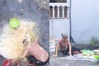 Đổ cả thau nước mắm vào mẹ chỉ để ăn mừng kênh đạt 1K sub, thanh niên bị ném đá sấp mặt vì bất hiếu