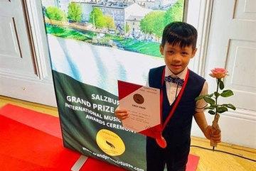 Little boy wins international music prizes