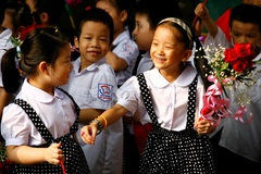 Despite ban, Vietnamese children are taught to read and write before going to school