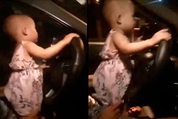 Clip bé 2 tuổi cầm vô lăng ô tô chạy băng băng trên quốc lộ ở Hà Tĩnh
