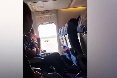 Khách TQ mở cửa thoát hiểm máy bay vì... bí thở