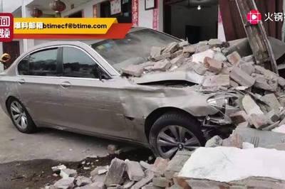 Mặc BMW đâm đổ tường, người trong nhà vẫn vui vẻ chơi mạt chược