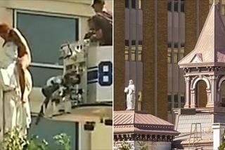 Xem giải cứu cô gái khoả thân mắc kẹt trên tượng cao