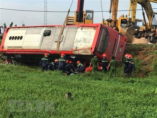 One dead and four injured after sleeper bus overturns