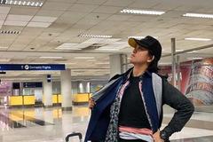 Mang hành lý quá cân, người phụ nữ nhồi nhét 2,5kg quần áo lên người